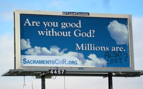 Vandalized billboard in Sacramento, CA.